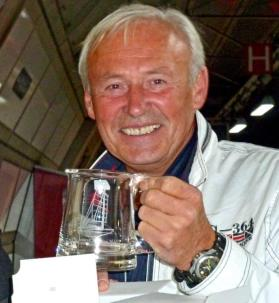 Igor Zaretsky, first home in the 2010 JC, gets his Jester mug (in the Underground at Heathrow!) ©Roger Taylor